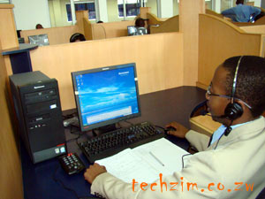 A call center agent at a station