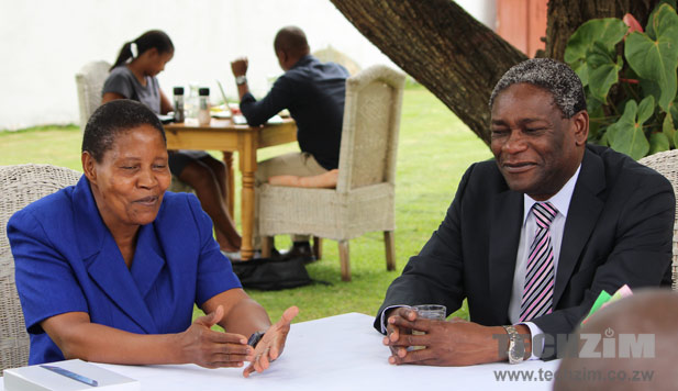 Marnet Mpofu, left, speaks at an event hosted by Luke Ngwerume