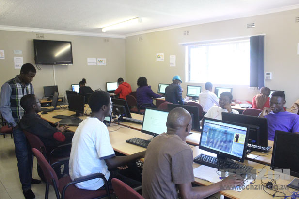 Some of the Muzinda Hub Digital Skills students, in the work centre
