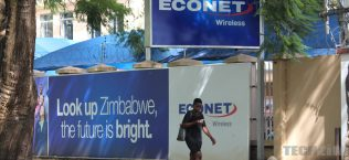 Econet sign, woman on phone