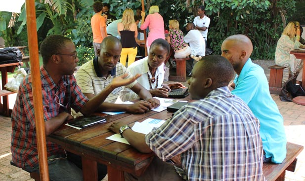 A team at the CultureShift Zimbabwe Ideation event discusses a book distribution solution for writers in Zimbabwe
