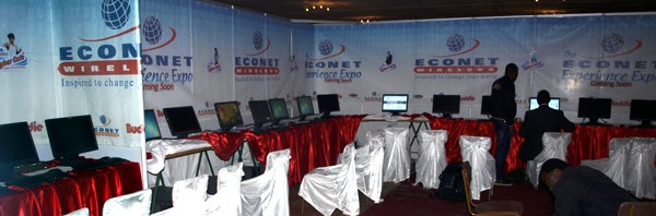 Econet technicians setting up a free internet Cyber Cafe at the Harare Agriculture Show