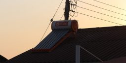 Geyser on roof, electricity pole, import