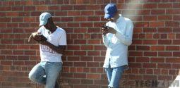 Two men holding phones, on social media